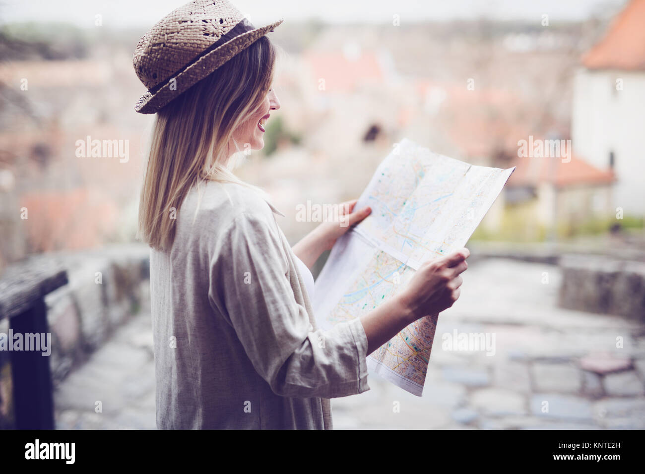 Happy female tourist sightseeing and exploring - Stock Image