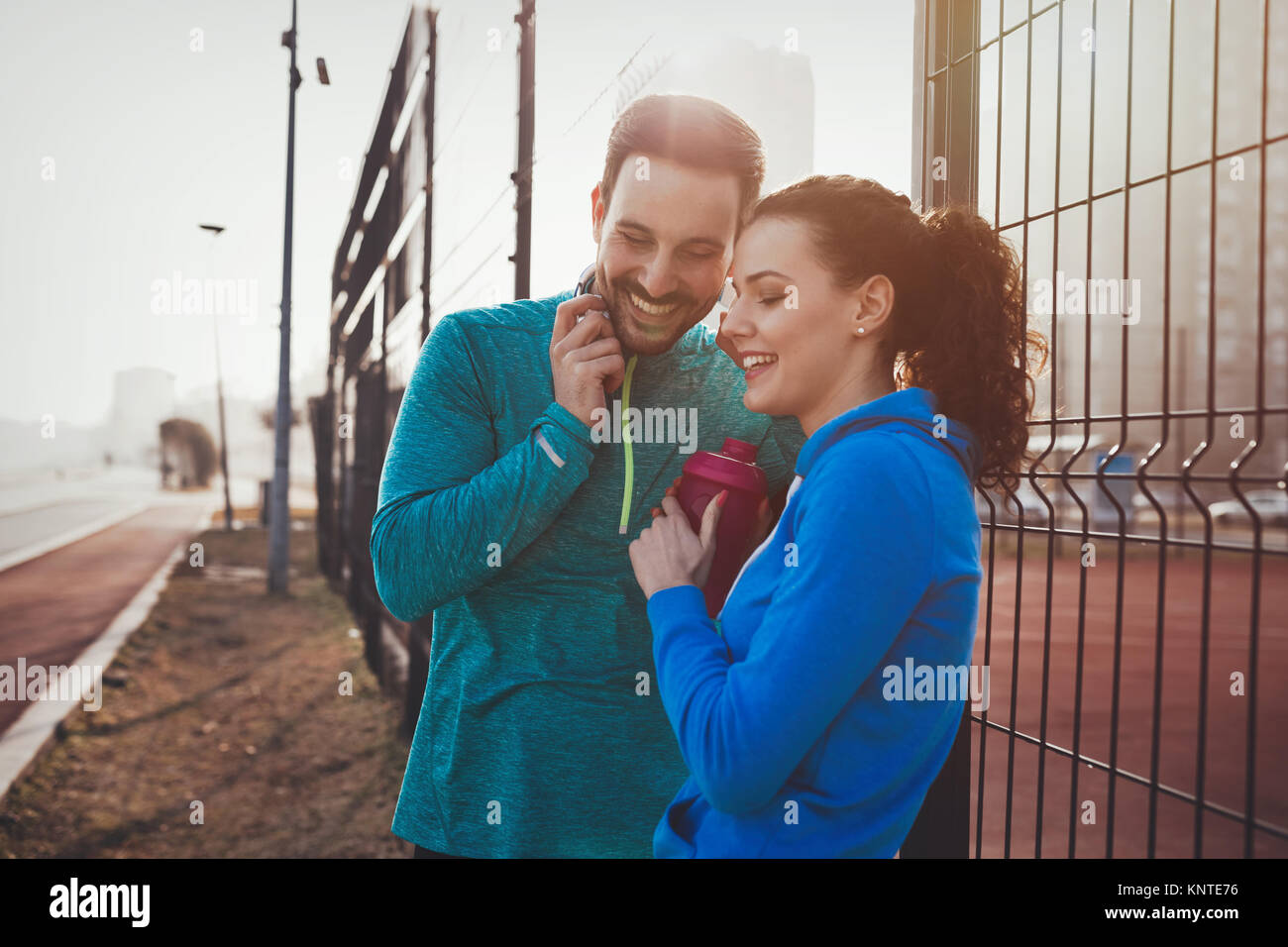 Sportsman and sportswoman flirting outdoor after fitness exercis - Stock Image