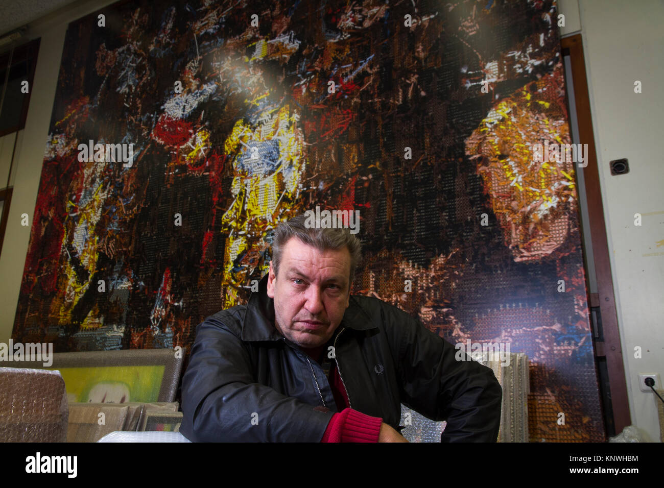 Portrait of Dutch artist Rob Scholte in his studio. - Stock Image