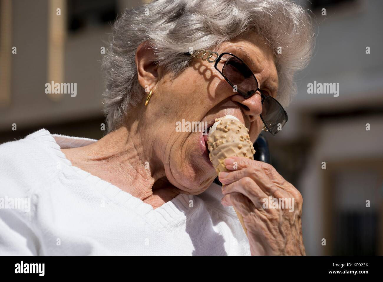 Grandmother eating ice cream, Valencia - Stock Image