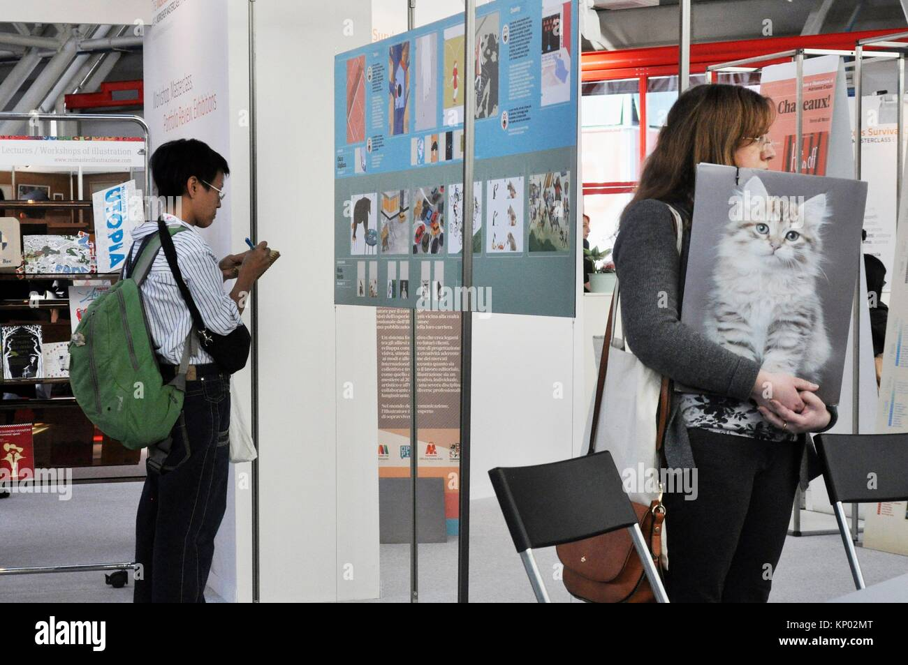 Bologna, Italy: an illustrator waiting to submit her portfolio at Bologna Children´s Book Fair - Stock Image