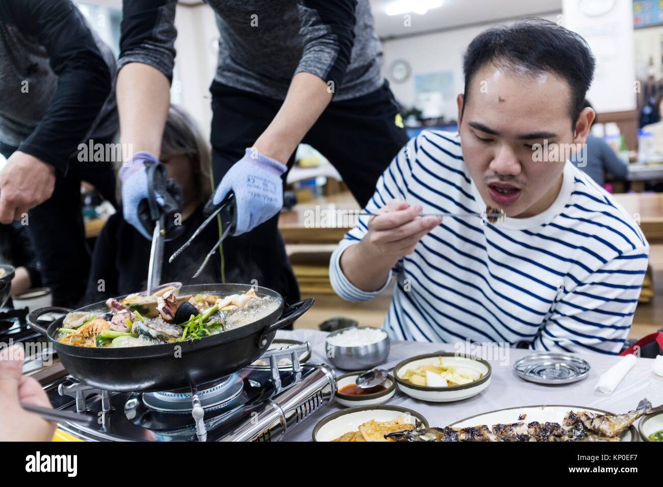 Eating seafood steamboat in Jeju Island, Korea. - Stock Image