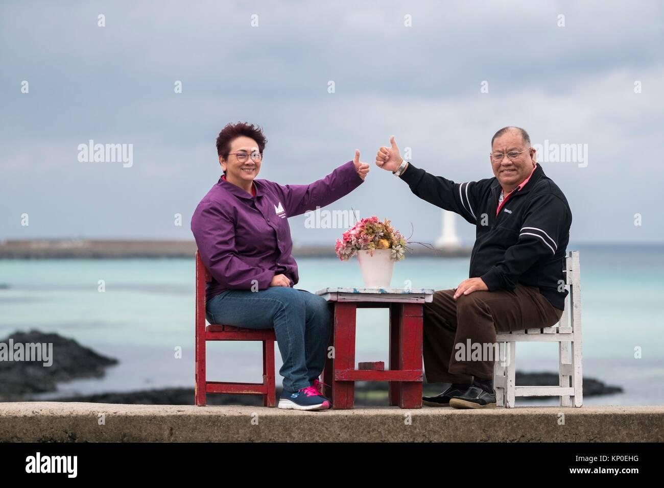 Happy couple at Jeju Gimnyeong Seongsegi beach, Korea - Stock Image
