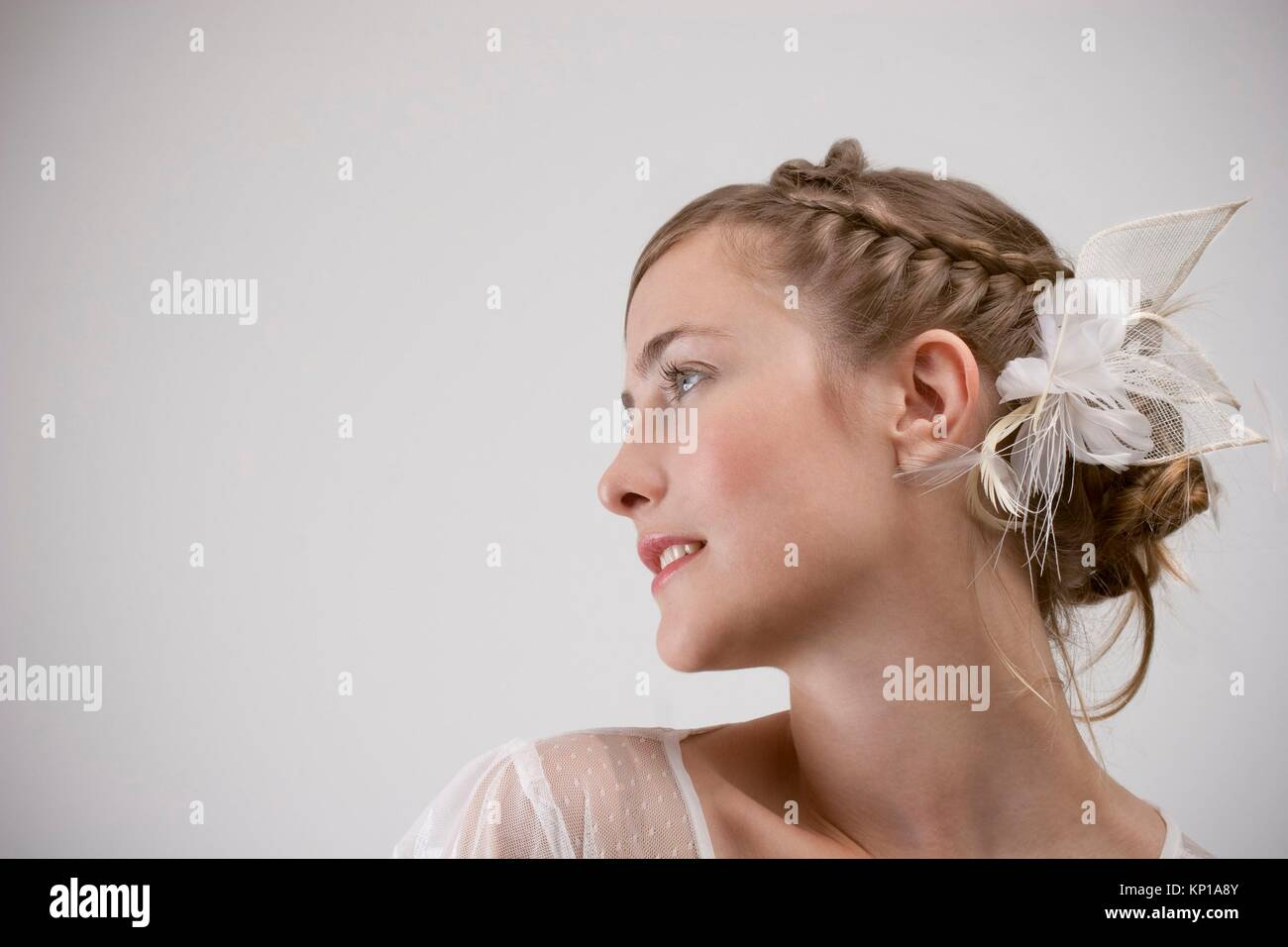 woman with a headdress - Stock Image