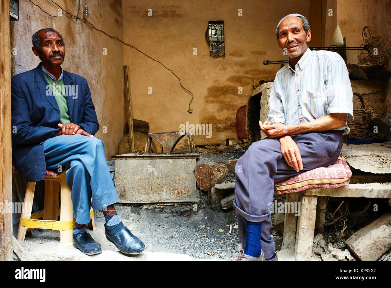 Two senior men relaxing in the medina of Fez, Morocco - Stock Image