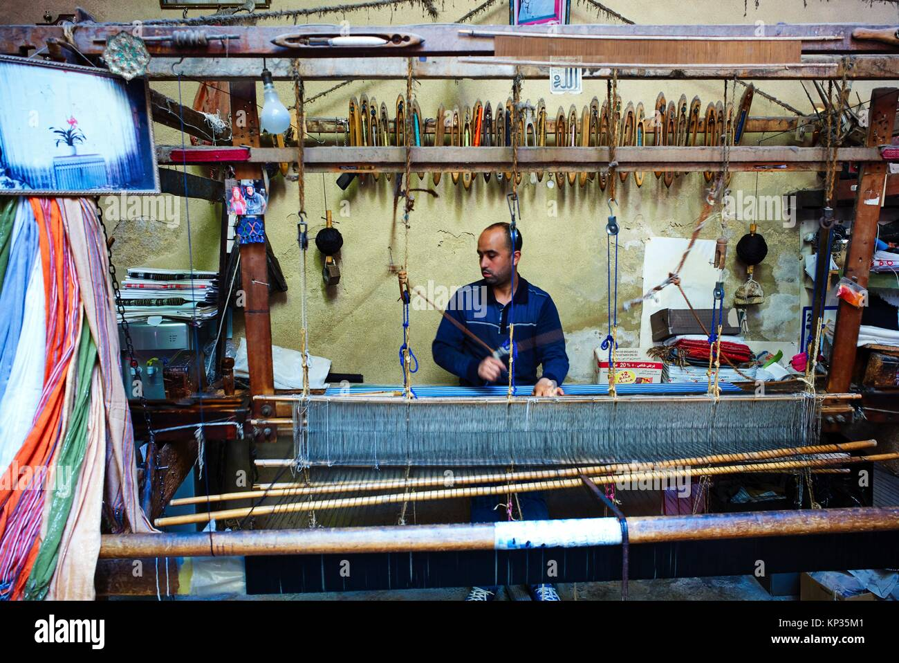 Weaving silk in the medina of Fez, Morocco - Stock Image