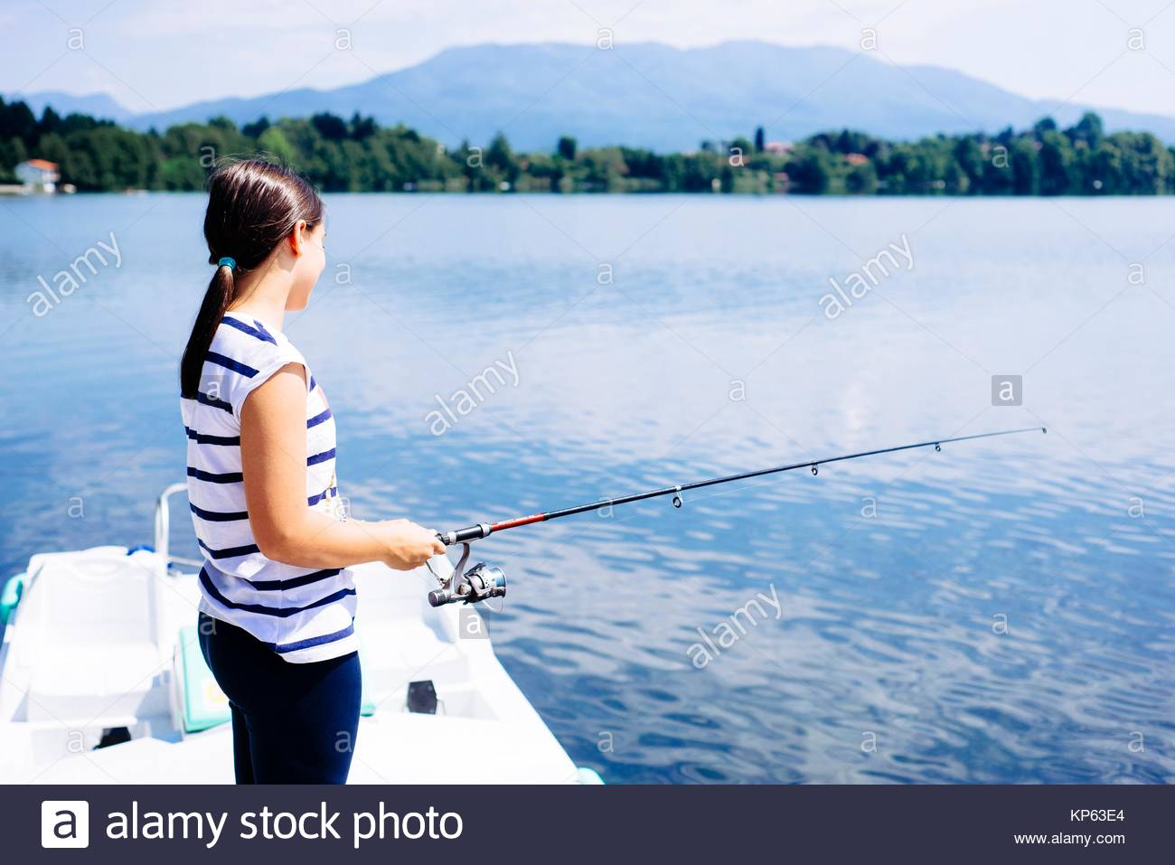 girl fishing in the lake of Monate., Italy - Stock Image