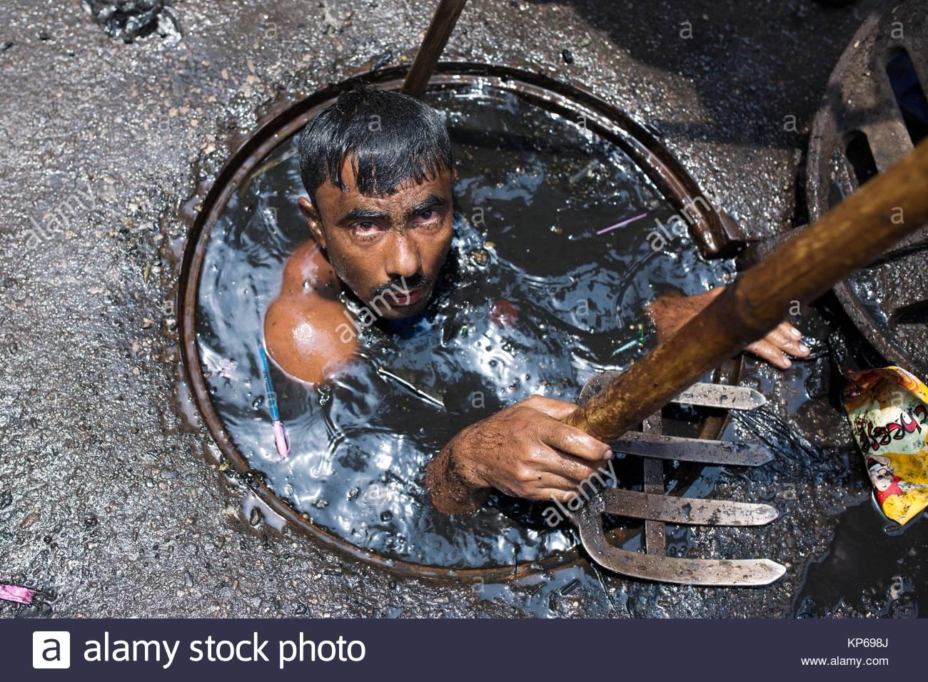 dhaka-bangladesh-may-03-a-sewer-cleaner-