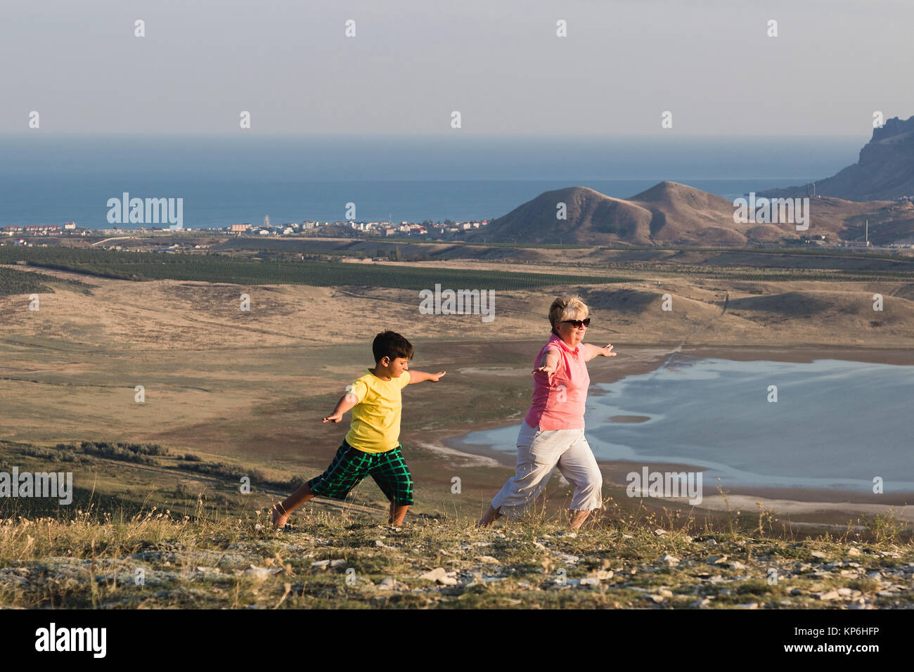 granny and grandson make a stretching - Stock Image