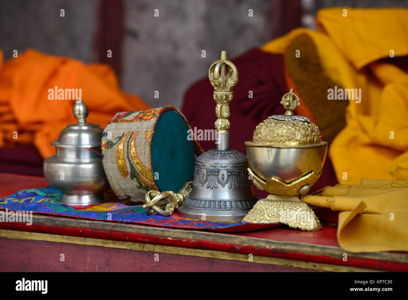Ritual Buddhist Objects For Puja: A Tibetan Bell, A Drum And Silver Bowls On