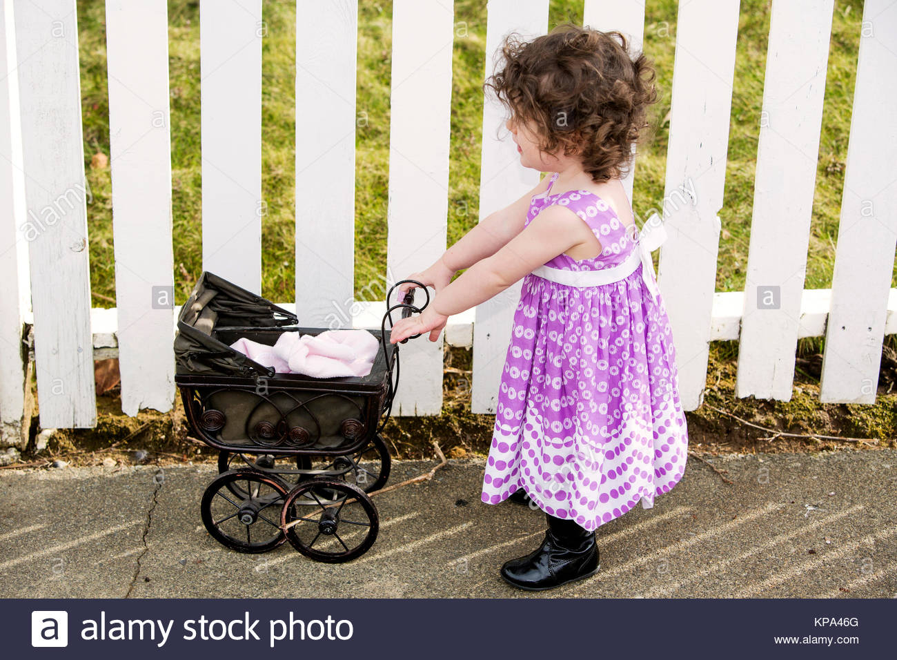f7a4a11fc little girl pushing a vintage stroller Stock Photo  168638584 - Alamy