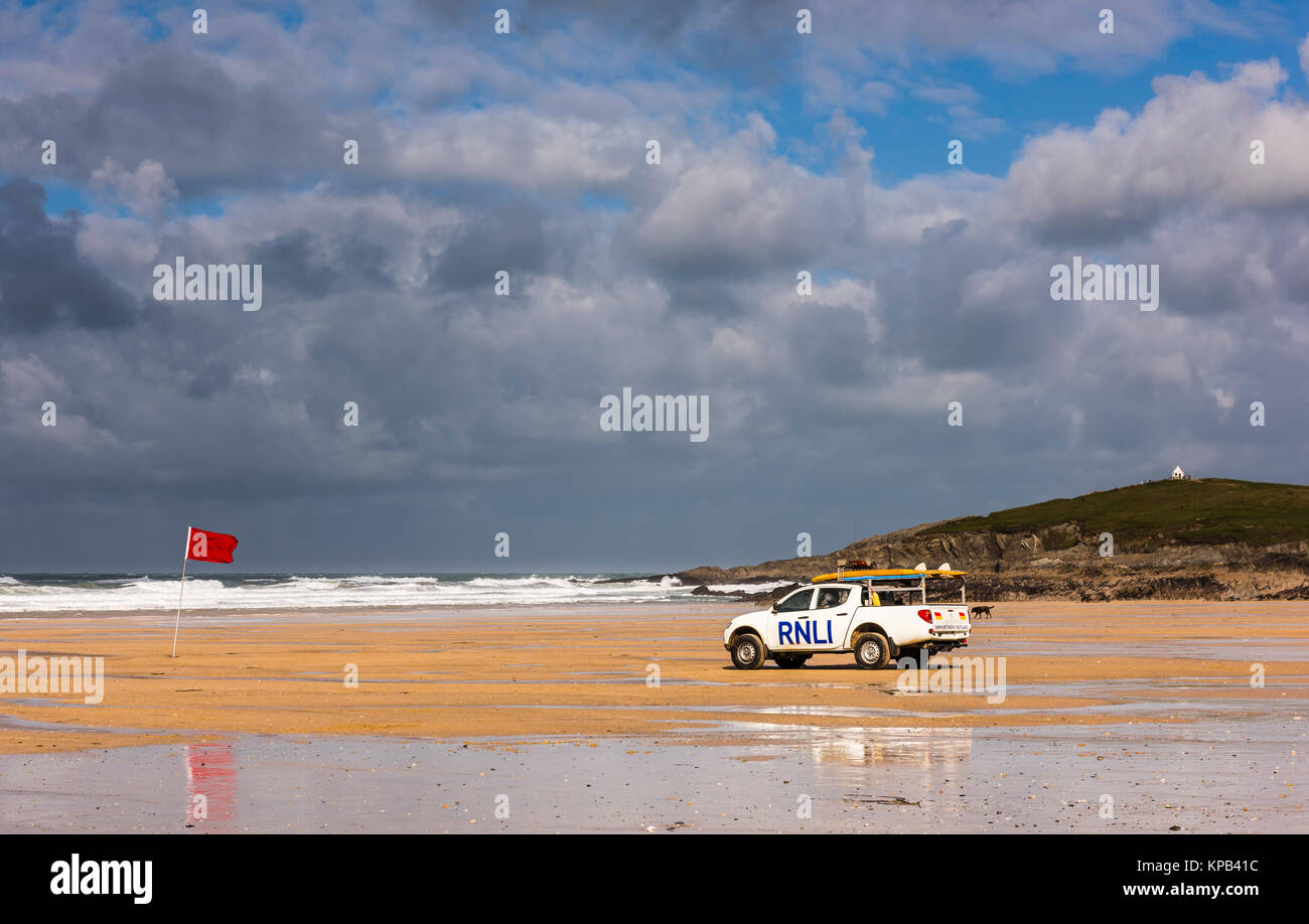 Atlantic Storm Brian and red flag at Fistral Beach, Cornwall, UK - Stock Image