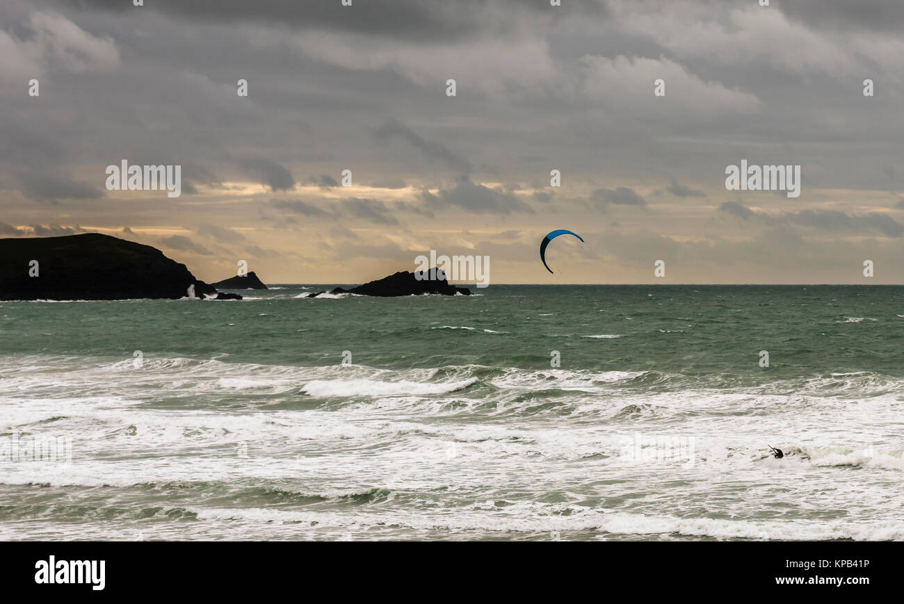 Kite surfing during a storm at Fistral Beach, Cornwall, UK - Stock Image