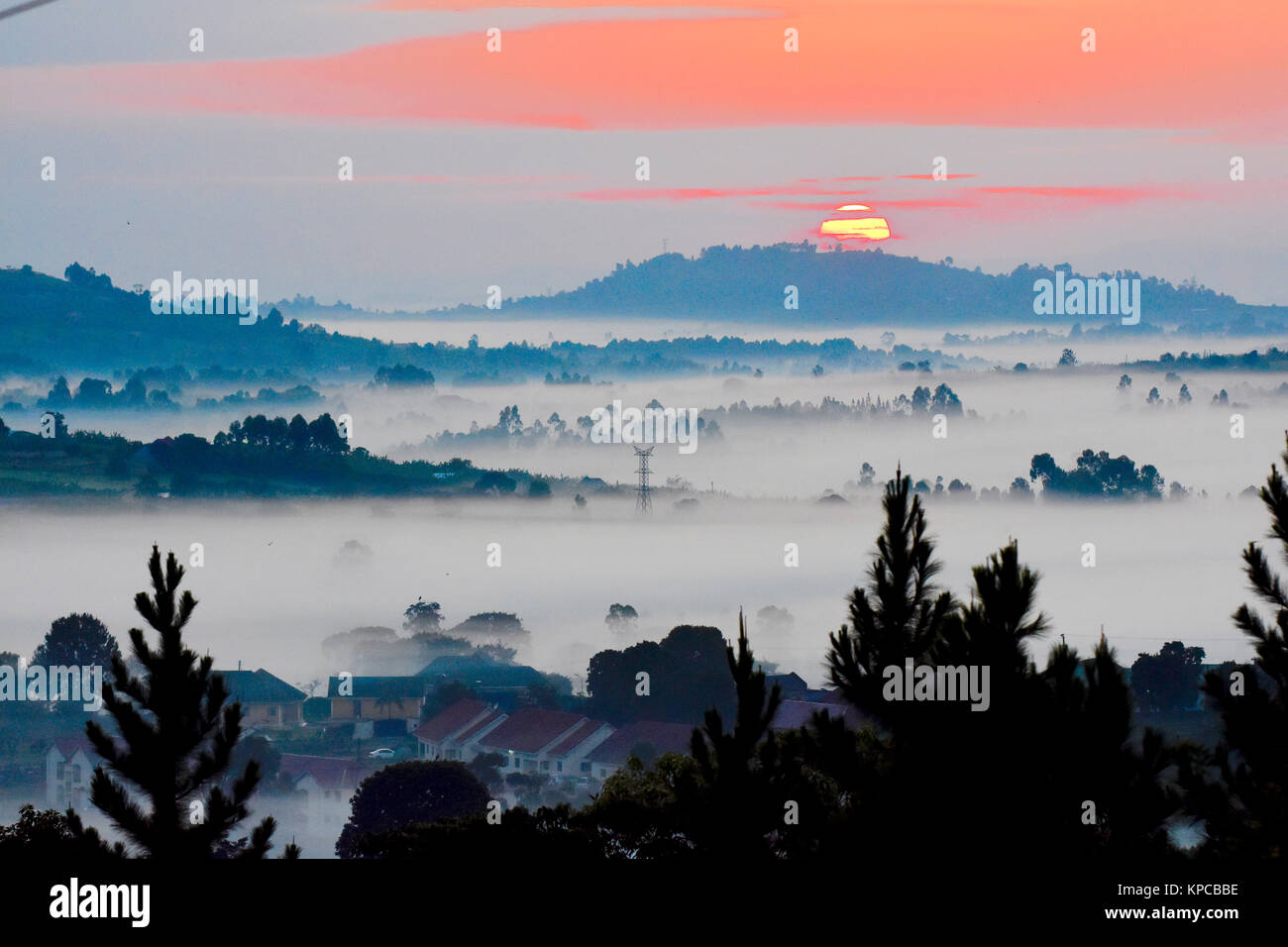 Sunrise over misty valles of western Uganda. - Stock Image