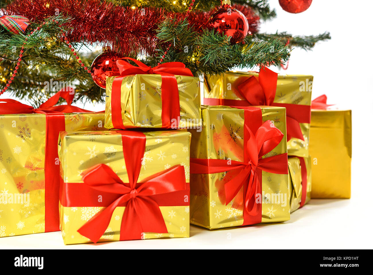 Luxury gifts in golden box with red ribbon under a beautiful Stock ...