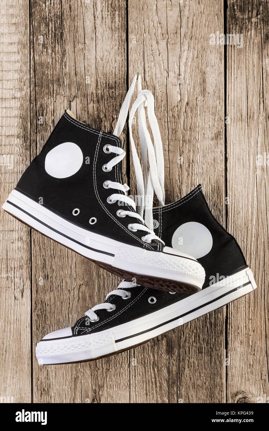 Black sneakers on wood backgroundStock Photo