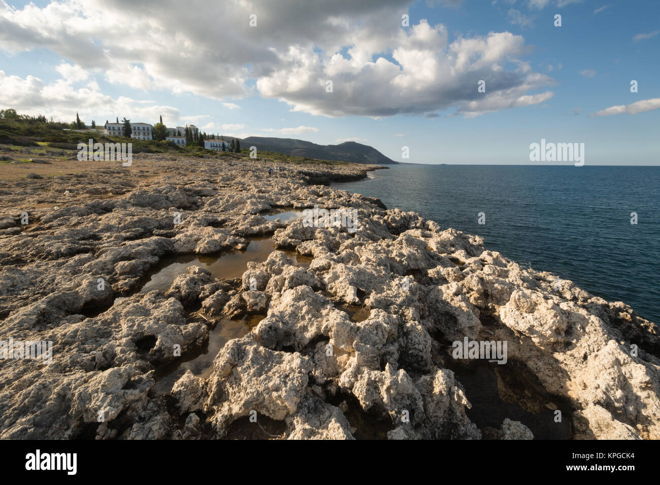 limestone-scenery-with-rock-pools-next-to-the-sea-near-latchi-in-cyprus-KPGCK4.jpg