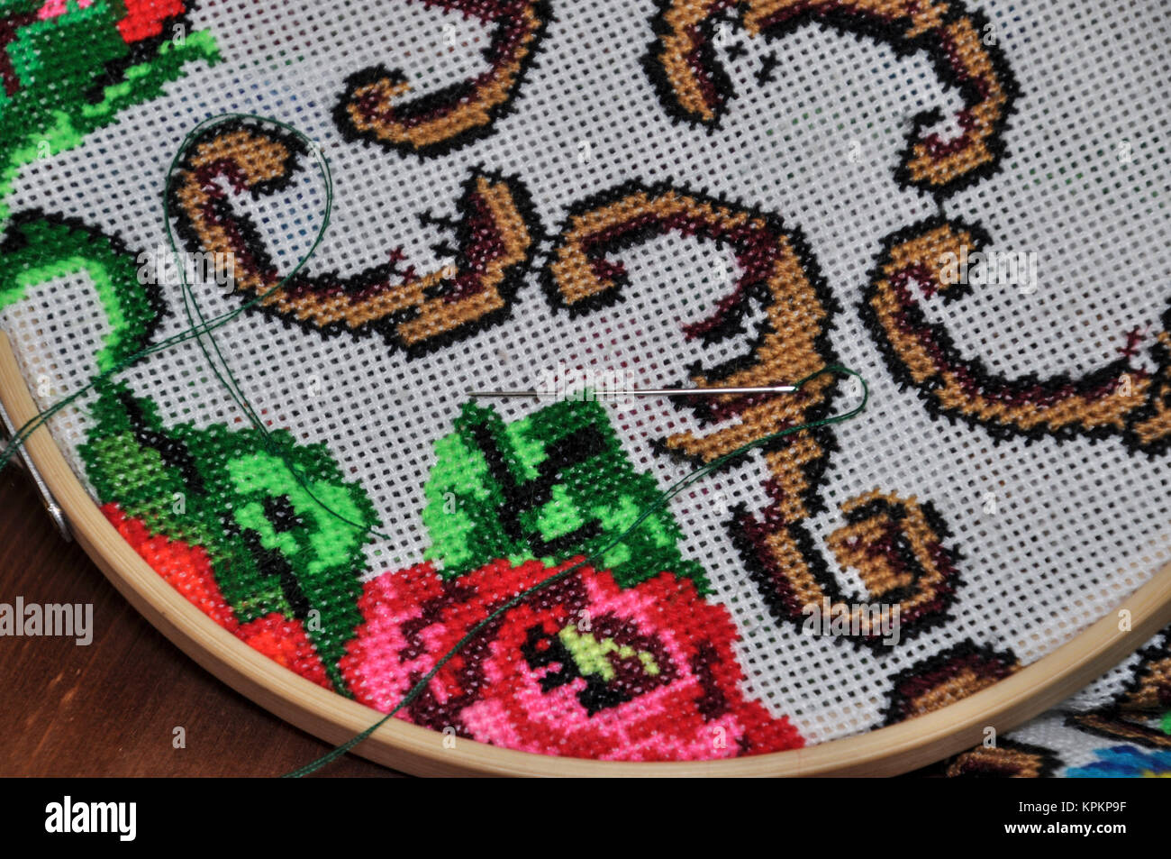 Closeup wooden hoop with the embroidery stitch - Stock Image