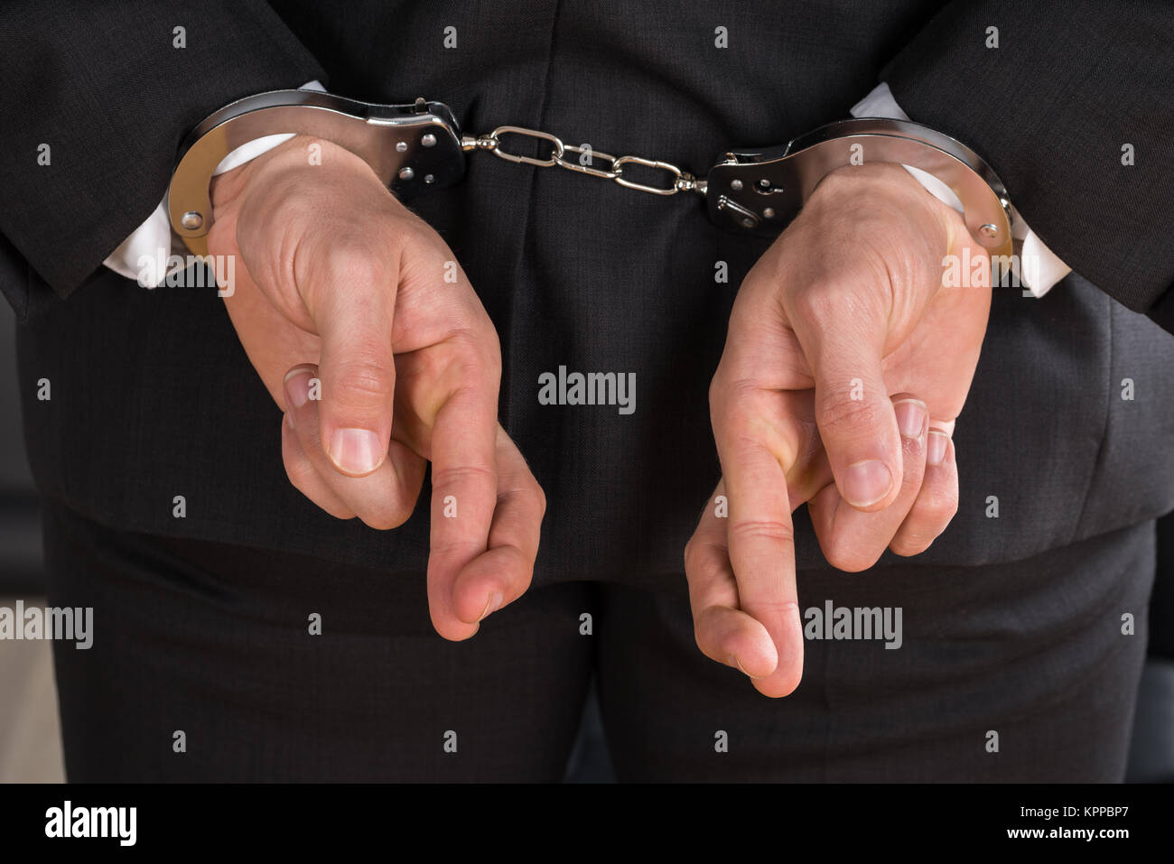 Businessman With Handcuffs - Stock Image