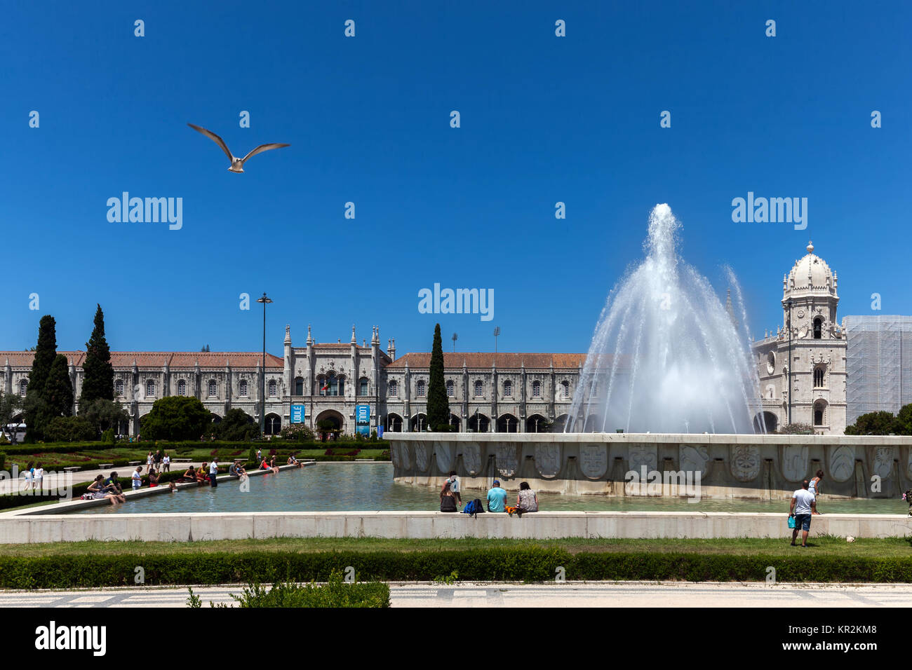 Lisbon, Portugal, August 6, 2017: Empire Square fountain and the Jeronimos Monastery. The square commemorates the - Stock Image