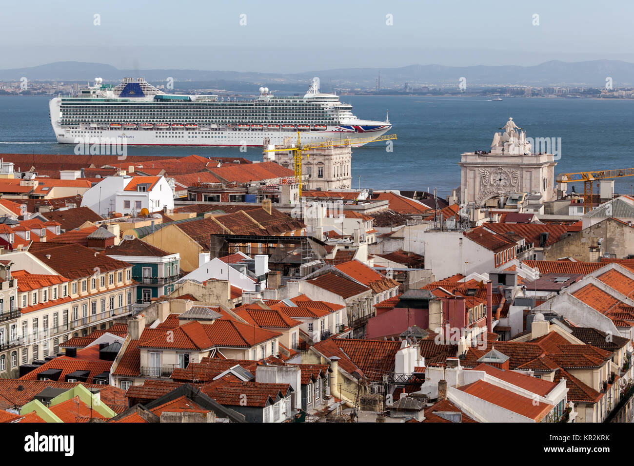 Cruise ship passing Lisbon, Portugal. View from the Santa Justa Lift. - Stock Image