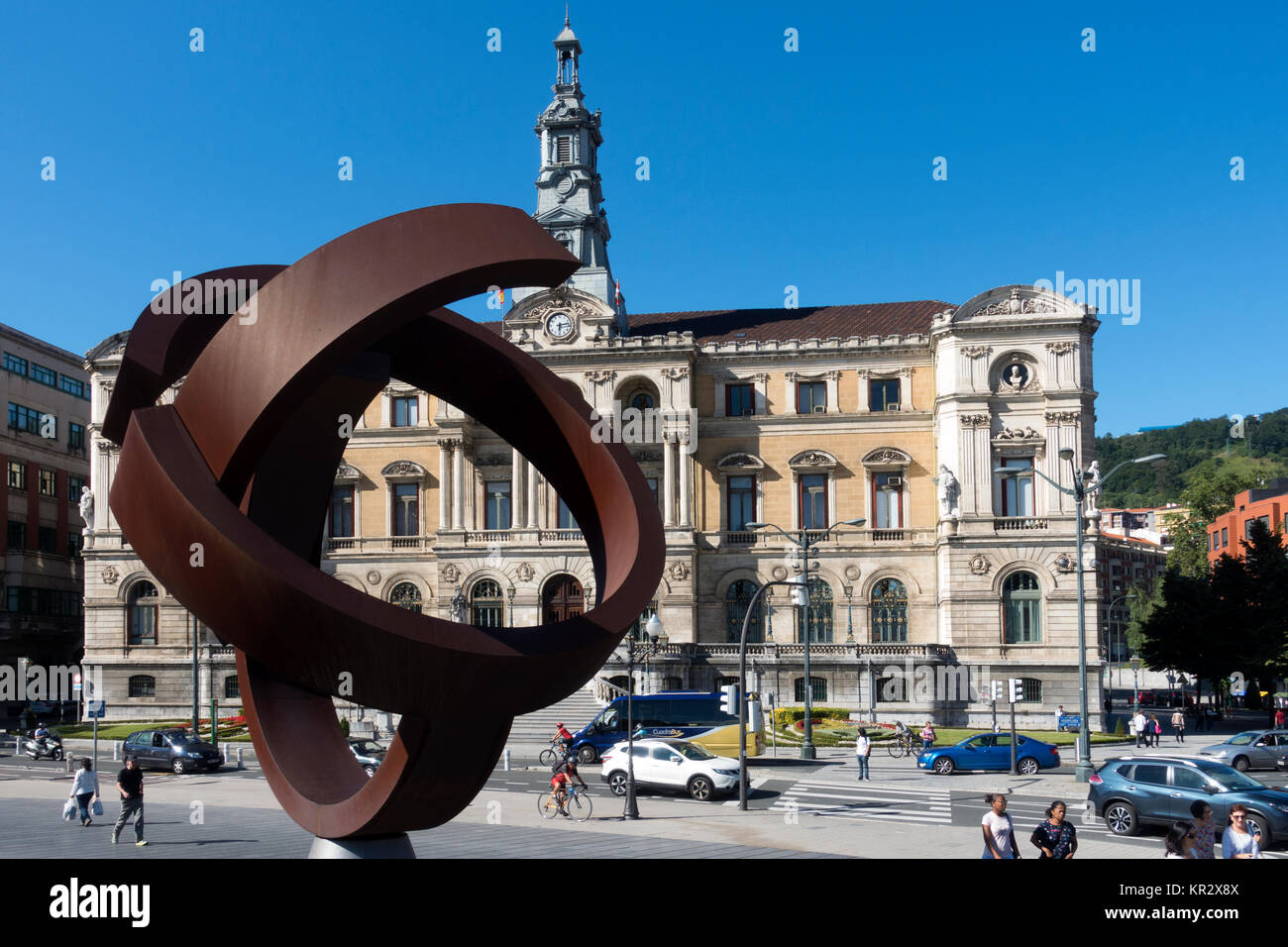Sculpture (artist: Jorge Oteiza Title:Variante Ovoide)and city hall.Bilbao.Vizcaya.Spain - Stock Image