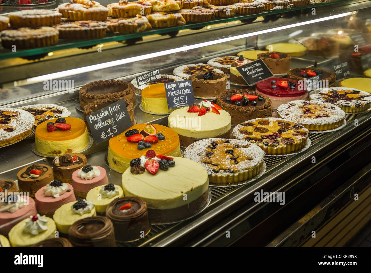 cakes-for-sale-in-a-display-cabinet-in-the-english-market-cork-ireland-KR399X.jpg