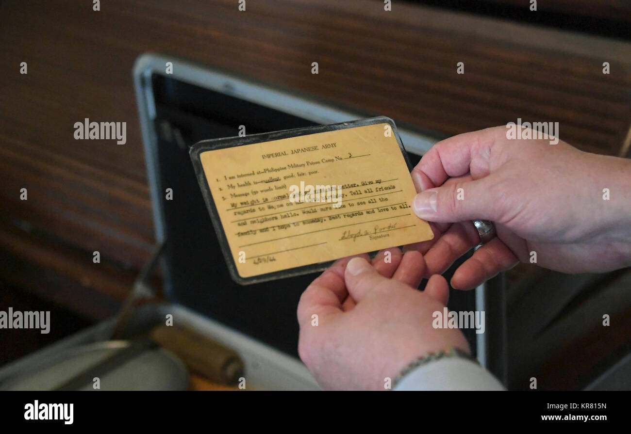 William Callaway, Eighth Air Force historian, holds an Imperial Japanese Army prisoner of war identification card - Stock Image