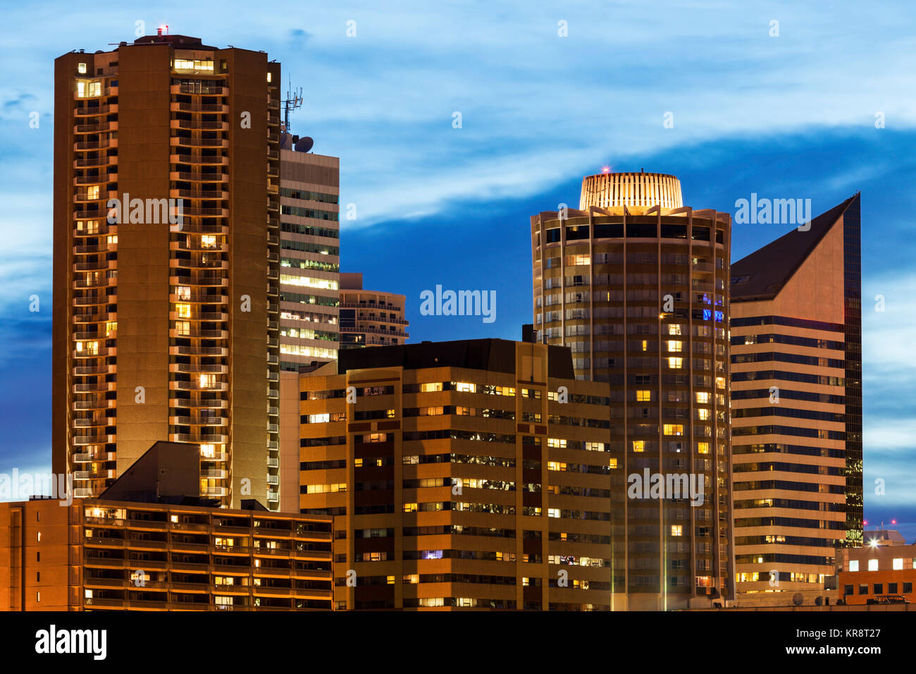 Canada, Alberta, Edmonton, Skyscrapers against moody sky - Stock Image