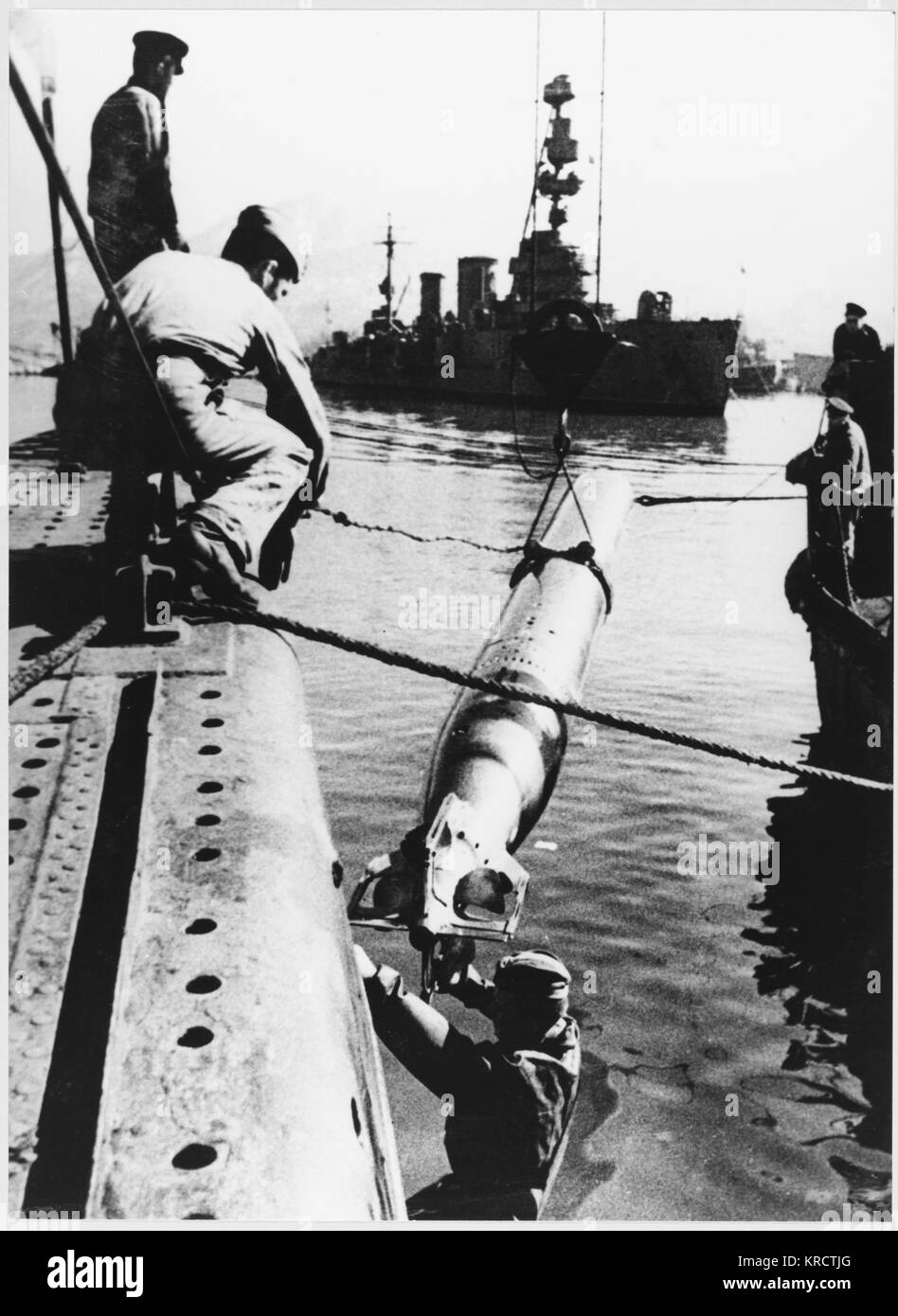 Re-arming a Soviet torpedo boat at Poti, on the Black Sea. - Stock Image