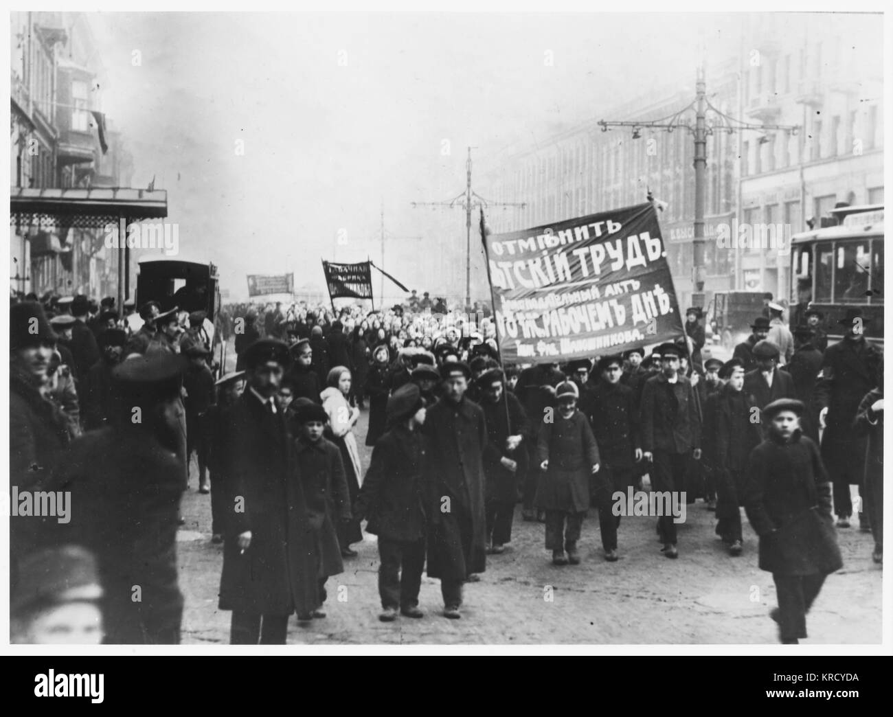 A procession of children  demonstrate for an 8-hour  working day and an end to  child labour.  Will the  Revolution - Stock Image