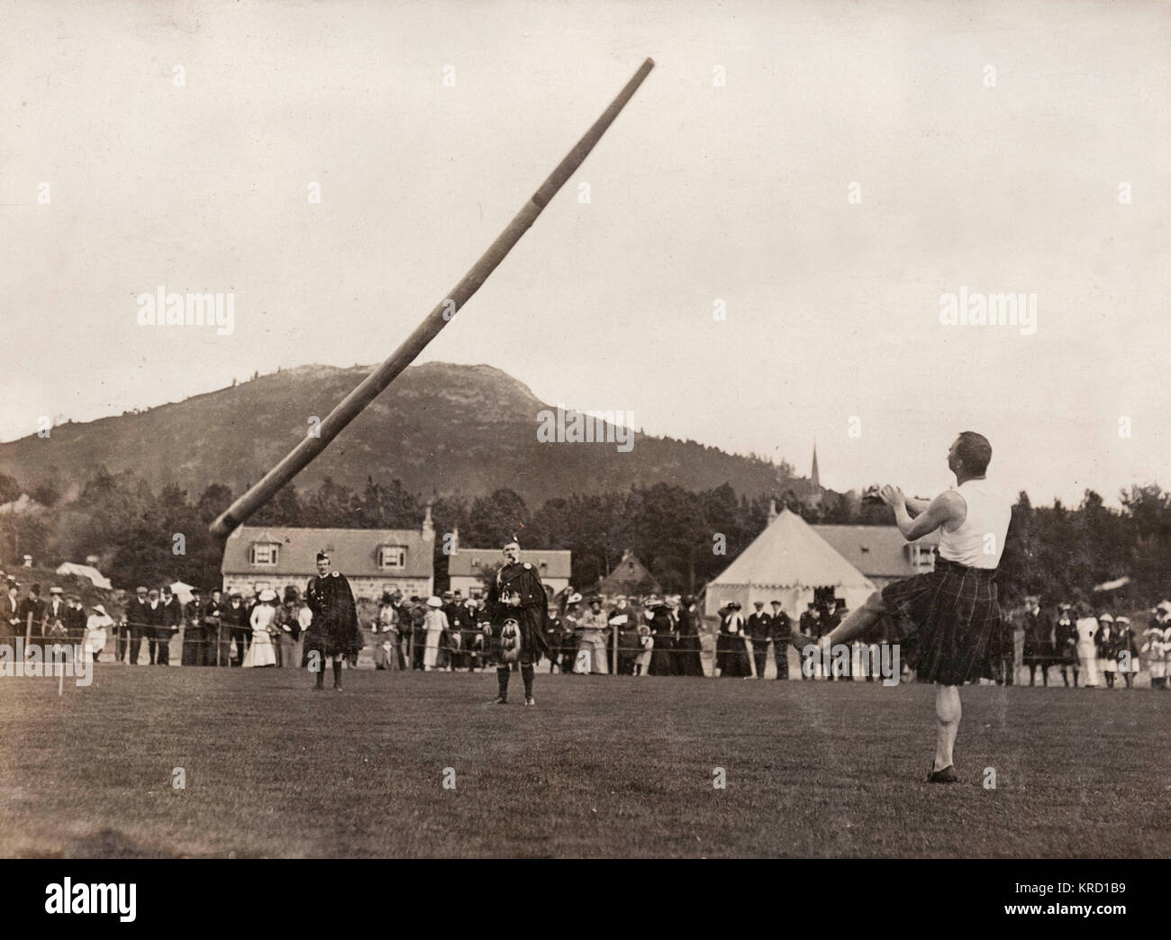 Scene at the annual Braemar Gathering, showing McIntosh of Partick tossing the caber.  Braemar in Scotland holds - Stock Image