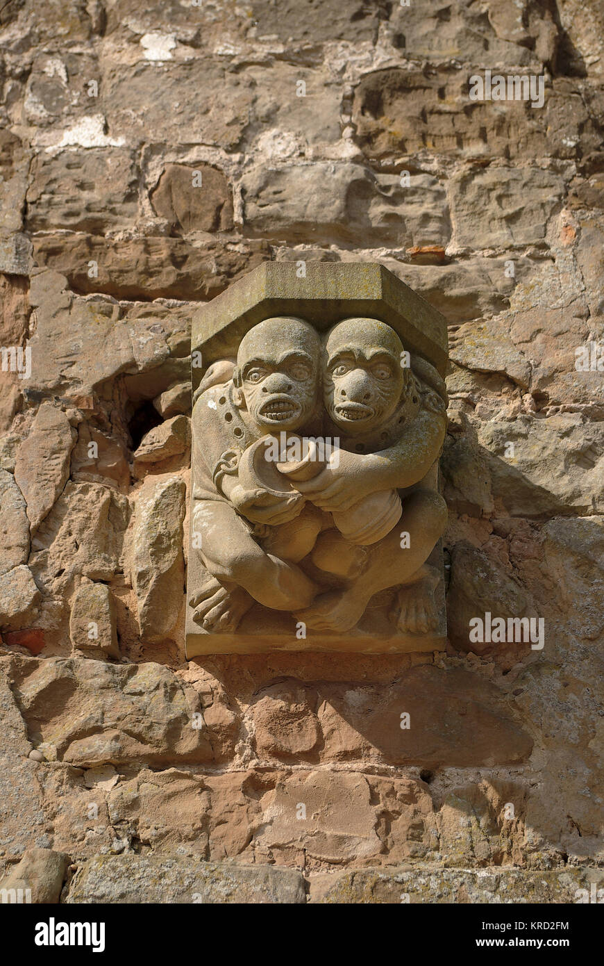 Close-up of gargoyles at Rufford Hall, Nottingham, showing two grotesque human figures huddled together.       Date: - Stock Image
