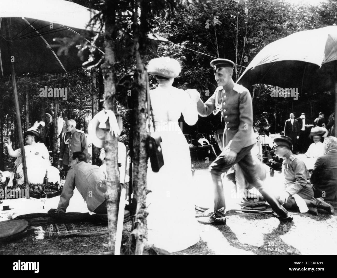 A picnic held in 1913 that is seemingly entirely consisting of members of the Russian aristocracy.     Date: 1913 - Stock Image