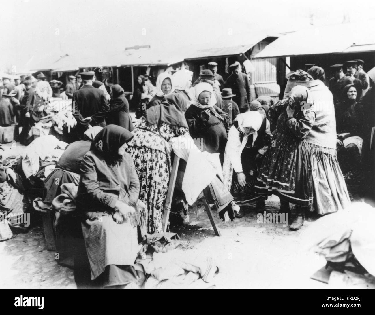 A Moscow clothes stall from around the turn of the 20th century.      Date: circa 1900 - Stock Image