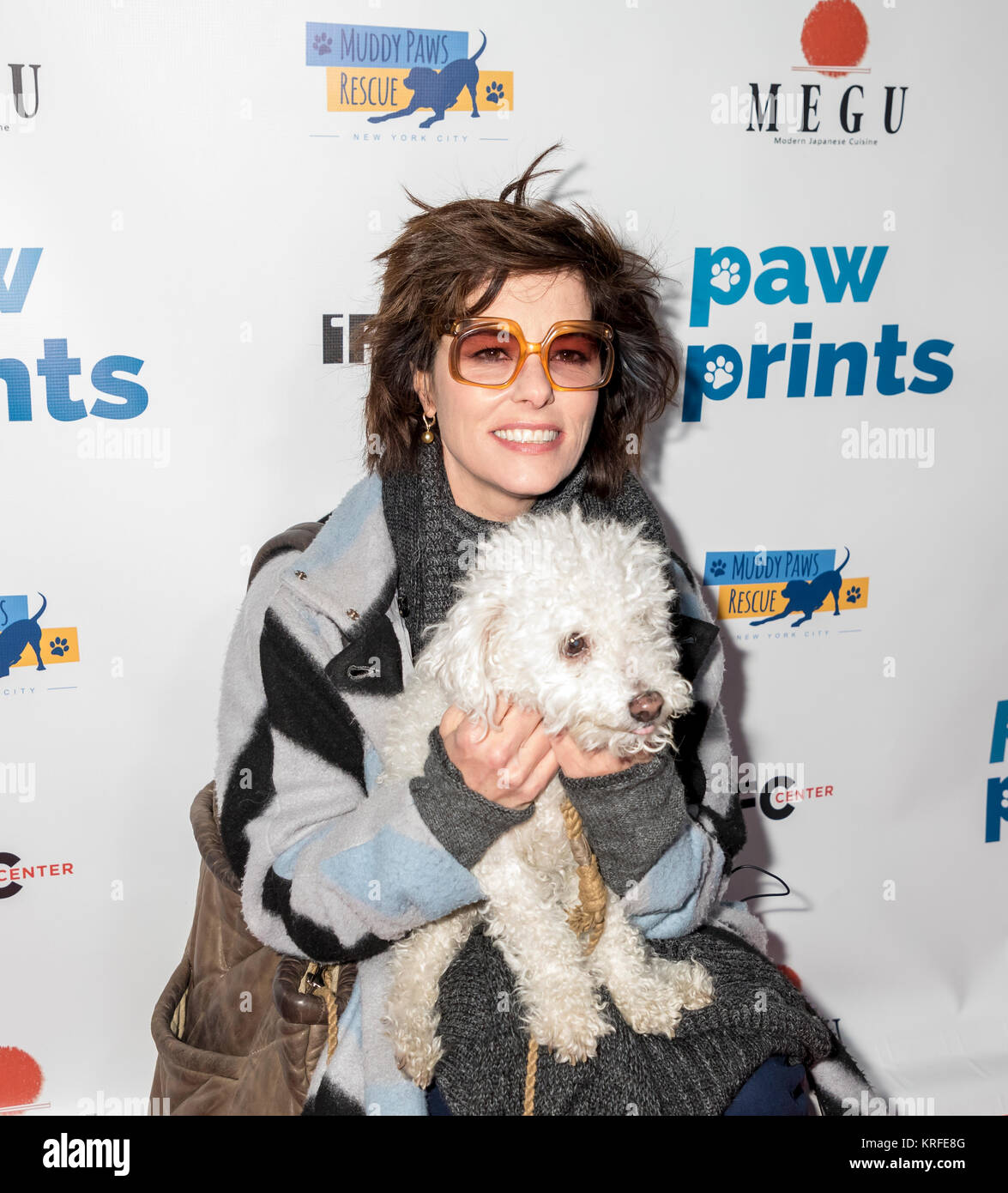 New York, NY, USA - December 19: Actress Parker Posey with her dog Gracie attend Paw Prints 1st Annual Paw-liday Stock Photo