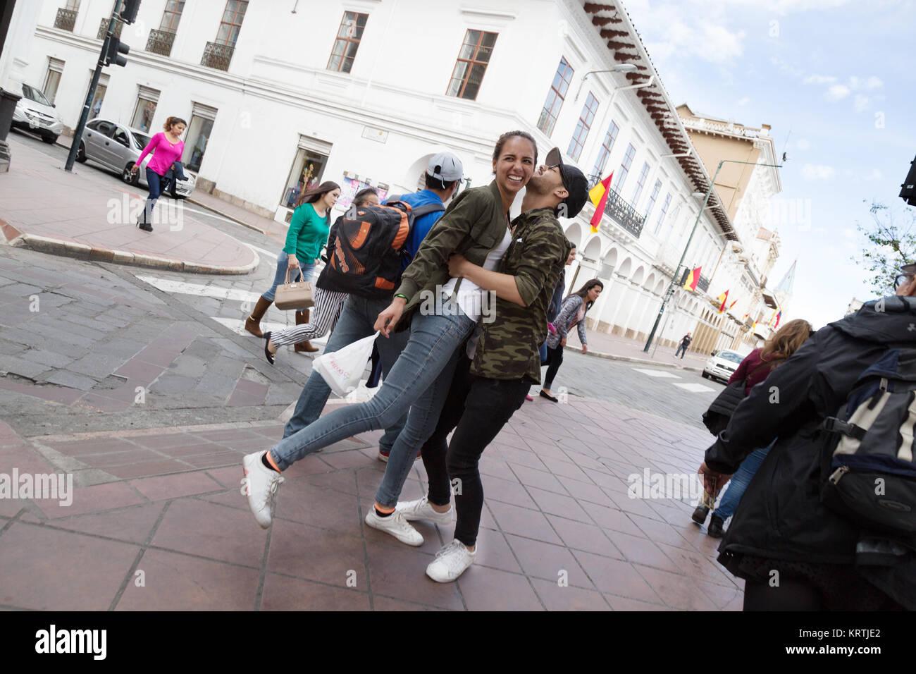 street-photography-ecuador-south-america-a-happy-couple-hugging-in-KRTJE2.jpg