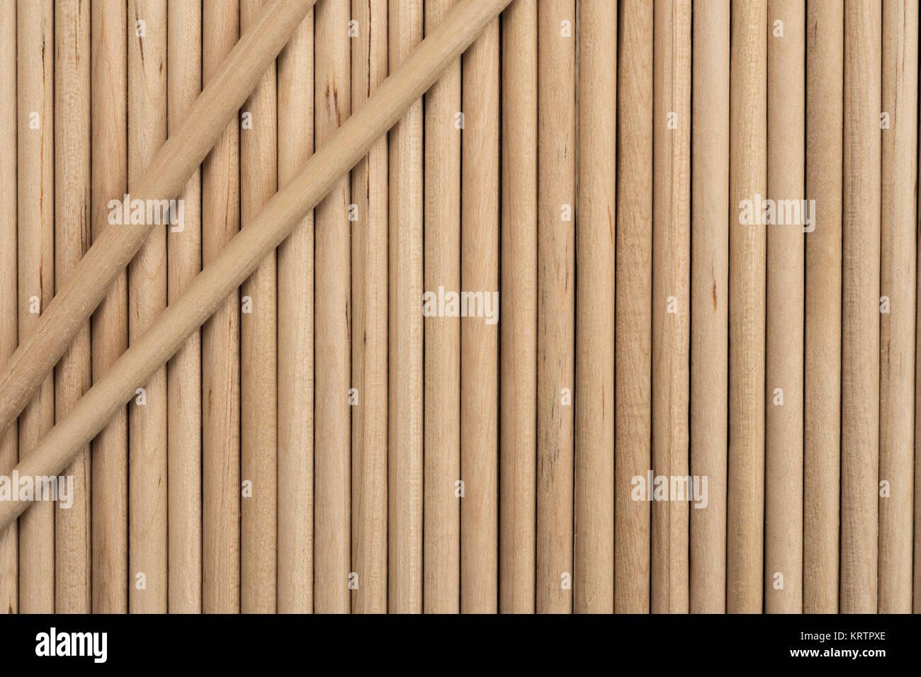 Close-up of wooden lollipop sticks. - Stock Image