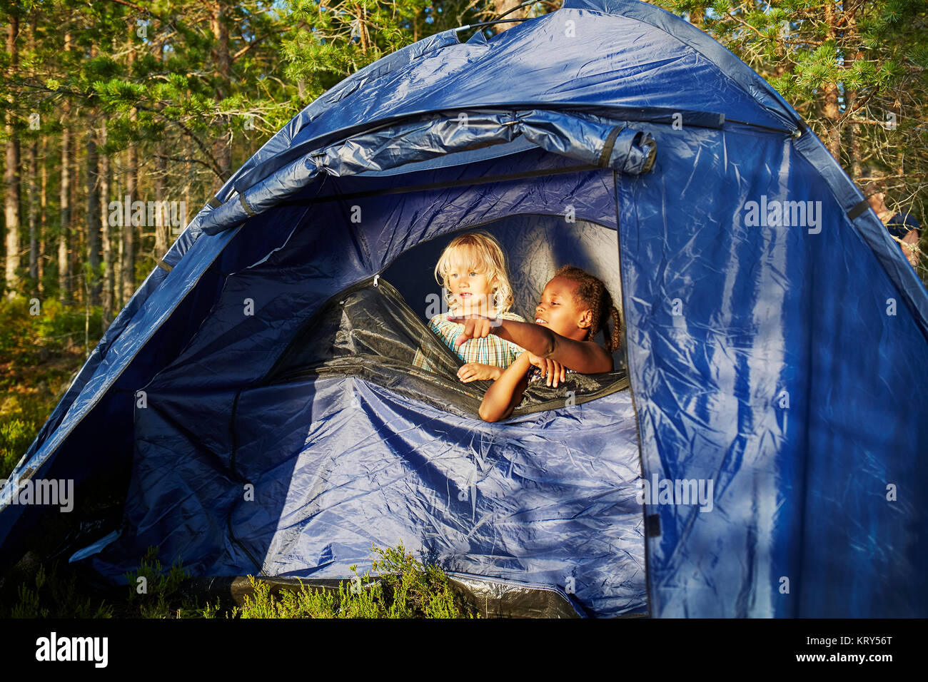 Girls in a blue tent - Stock Image