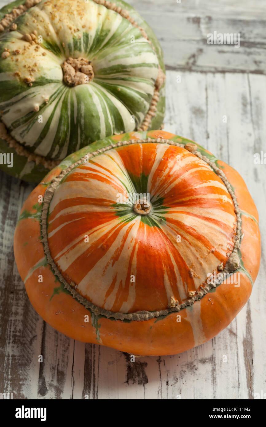 Fresh heirloom orange and green Turban squash - Stock Image