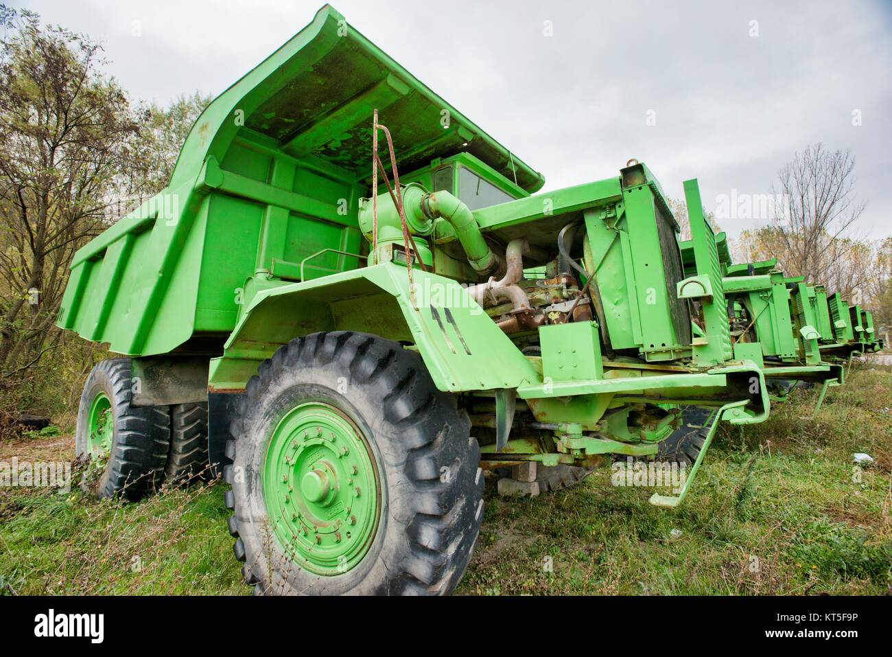 Aging rural communities such as Boljevac in Serbia - Old trucks - Stock Image
