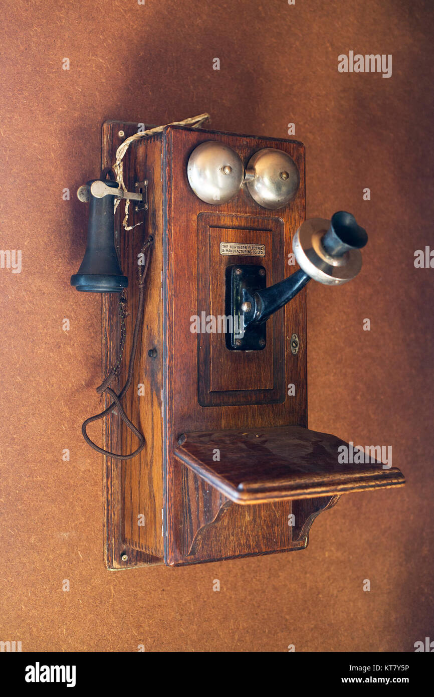 Antique telephone at Bar U Ranch National Historic Site - Stock Image