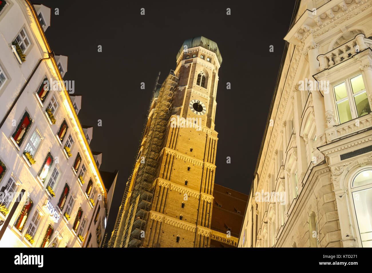 MUNICH, GERMANY - DECEMBER 11, 2017 : A view of the Cathedral of Our Lady at night in center of Munich, Germany. - Stock Image