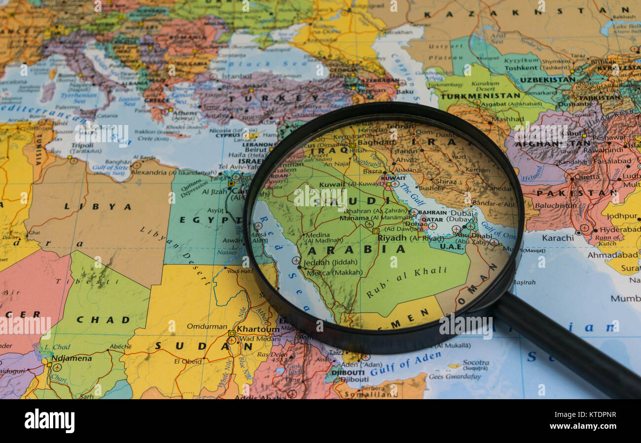 Saudi Arabia Map Through Magnifying Glass On A World Map Stock Photo