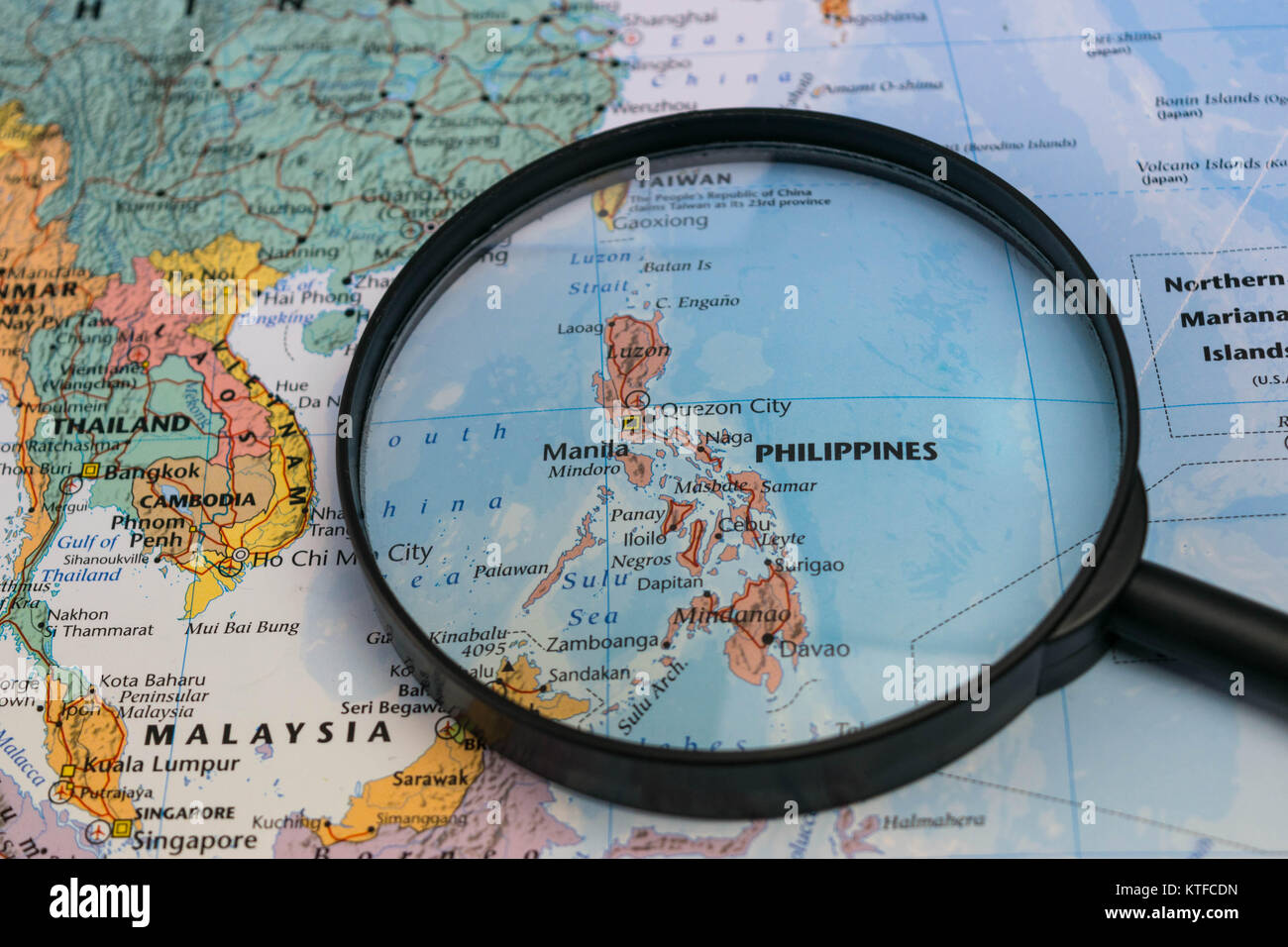 The Philippines Map Through Magnifying Glass On A World Map Stock