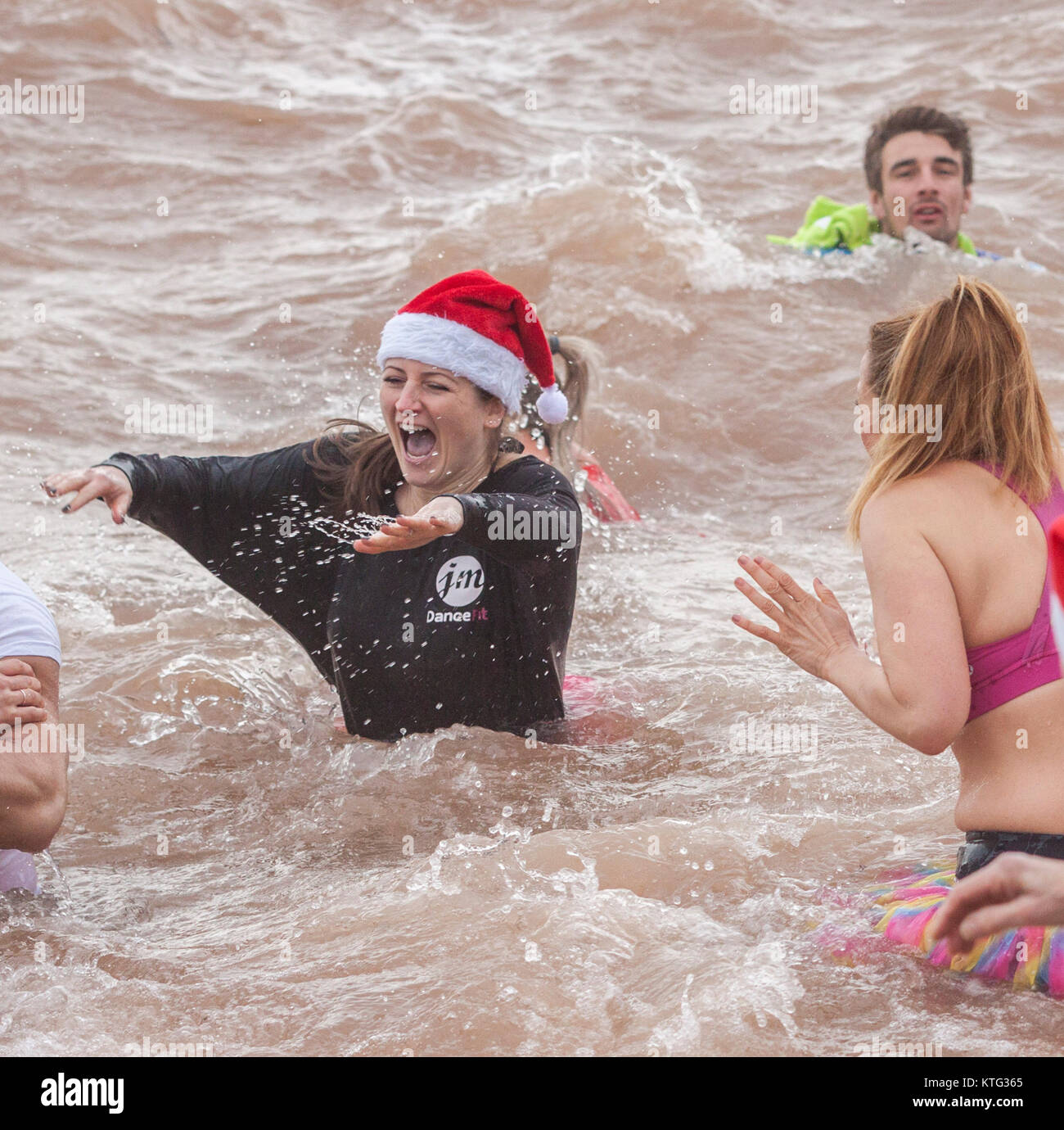 Sidmouth, Devon 26th Dec 17 Brrrrr! Hundreds braved the freezing cold sea  to join the annual Boxing Day swim at Stock Photo