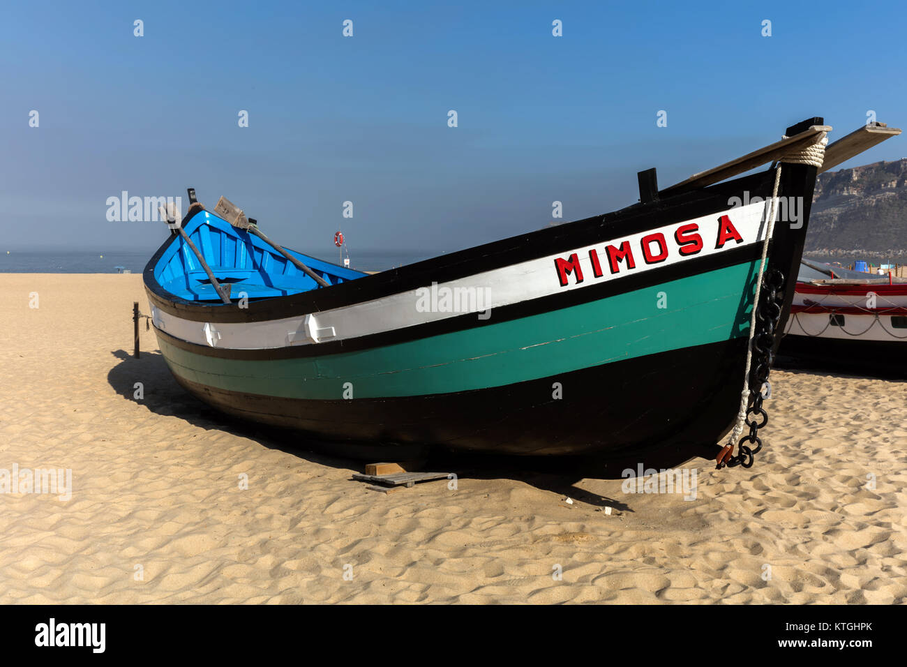 Nazare, Portugal, August 12, 2017: Historic examples of the colorful fishing boats used by the local fishermen not - Stock Image
