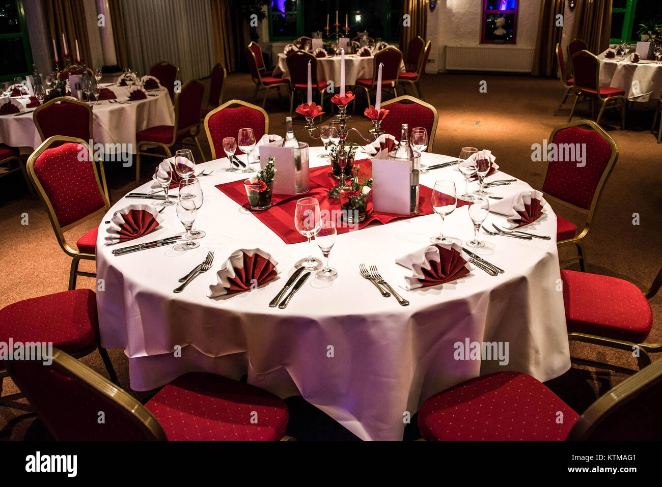 Banquet With Red Table Setting Red Tablecloth White Dishes Silver