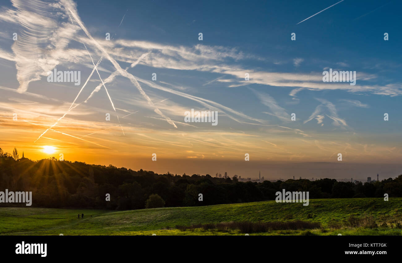 Stunning sun rays over the London skyline from Hampstead Heath, London, UK - Stock Image