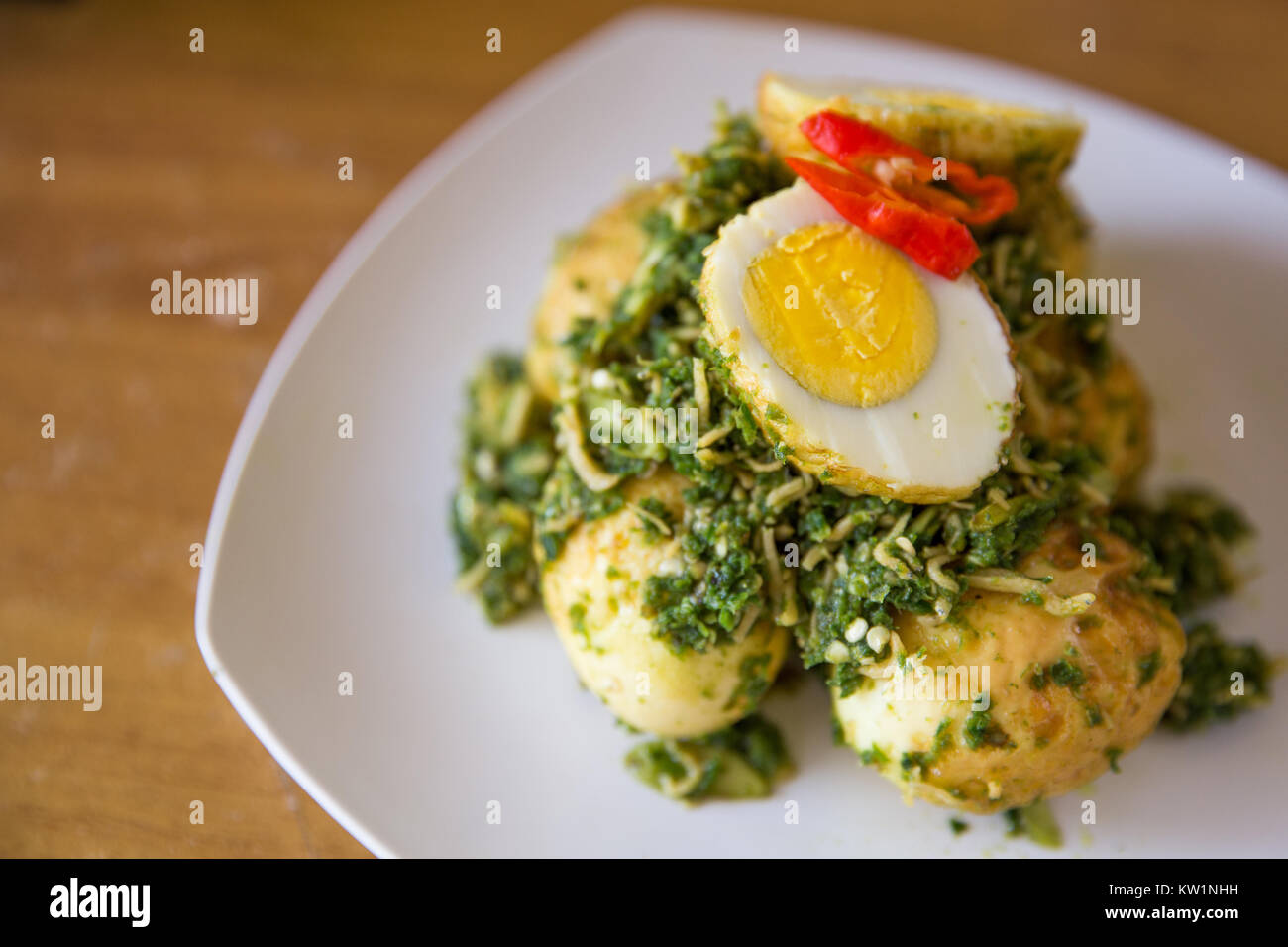 Stir-fry egg and green chili sauce mix with anchovy - Stock Image